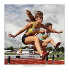 Women Jumping Hurdles
